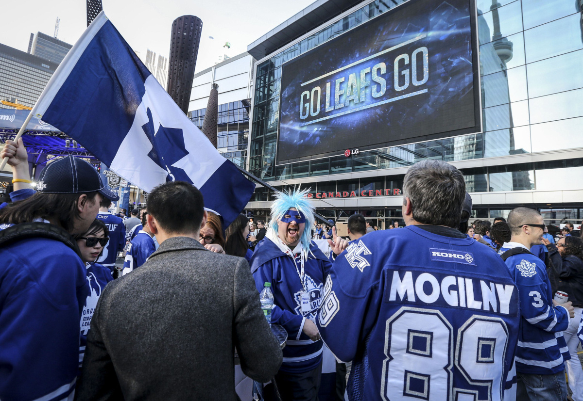 "Leafs/Marlies fan ""Marlie Man"" centre with blue and white hair cheers on the home side"